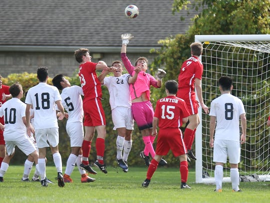 It's congested around Plymouth goalkeeper Chris Tsakoff (0), as he bats the ball away from traffic.