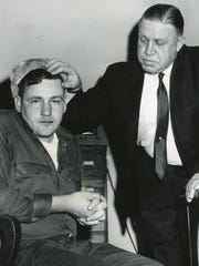 Knoxville Police Captain Fred Scruggs points to the bruised eye and cut mouth of Doug Willett.
