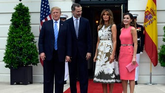 President Donald Trump poses with Spain's King Felipe VI, first lady Melania Trump, and Queen Letizia, at the South Portico of the White House, June 19, 2018.