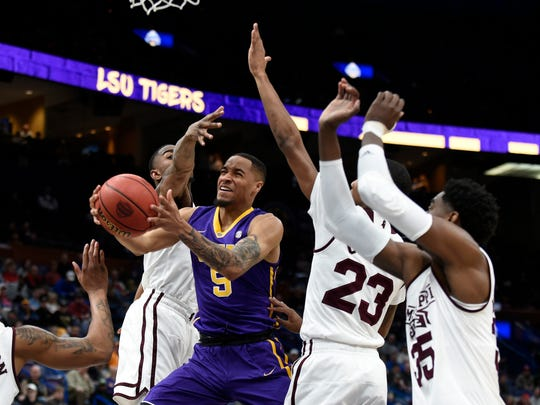 LSU Tigers guard Daryl Edwards (5) puts up a shot as the Mississippi State Bulldogs defend during the second half of the second round of the SEC Conference Tournament at Scottrade Center. Mississippi State won 80-77.