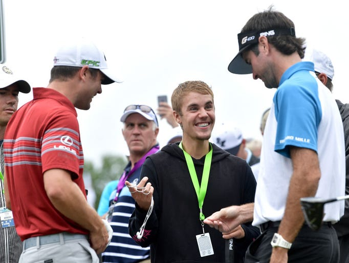 Musician Justin Bieber speaks to Wesley Bryan and Bubba
