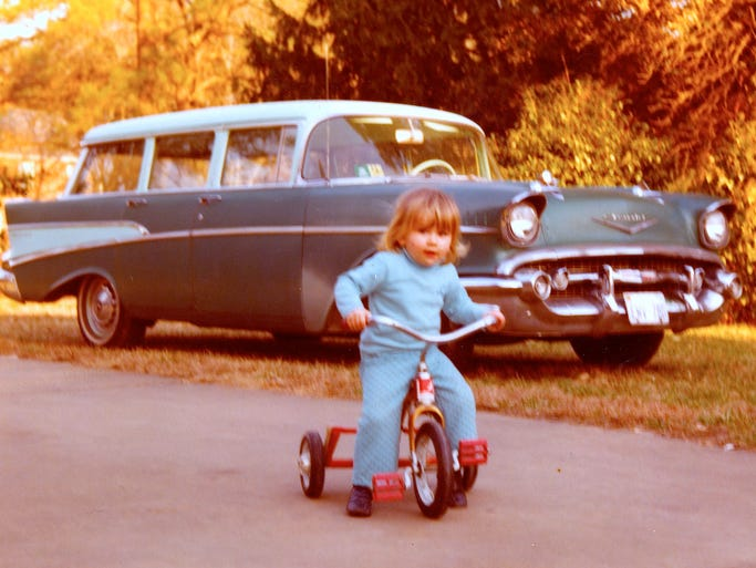 Photo of girl on trike is courtesy of Sid Pollard Jr. Behind her is the 1957 Chevrolet Bel Air Townsman station wagon  From the book,  Auto Biography: A Classic Car, an Outlaw Motorhead and 57 Years of the American Dream written by Earl Swift.