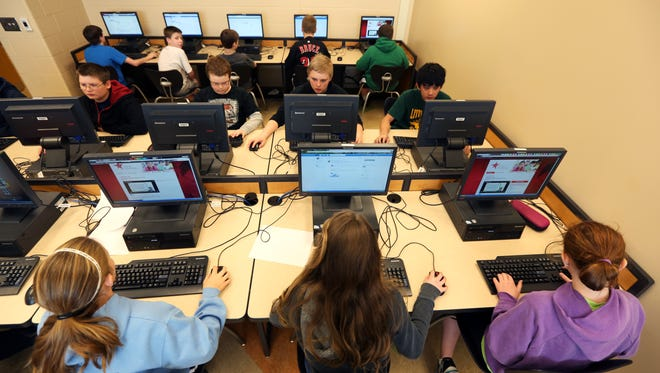 Seventh-grade students in Ellen Mason's computer class work on a project at Little Miami Middle School. The new Common Core curriculum would be evaluated by testing students, mostly online by computer.