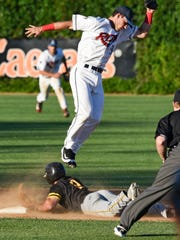 Dennis Karas leaps to try to make a play at second