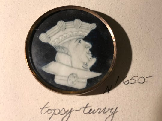Created around the time of the French Revolution, this button evokes 18th-century politics with a caricature of an aristocrat's face, which can be turned upside down to see another face. Men in the French court competed with each other to wear fine buttons like these at the time. Dealer Gary Brockman showed the buttons at the 77th Annual Button Show and Competition from March 8-10, 2018, at the Clarion Airport Hotel, 2500 S. High School Road.