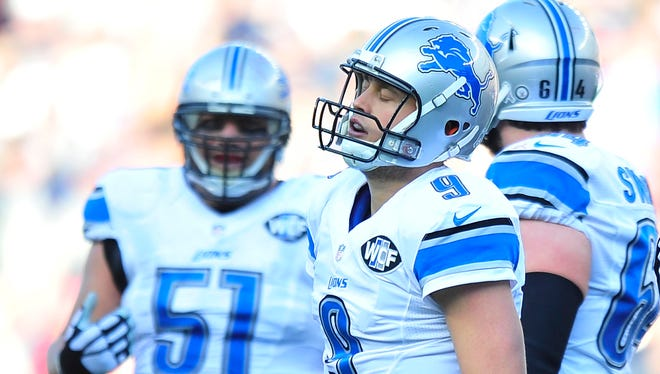 Lions quarterback Matthew Stafford walks off the field after being sacked in the first half. Stafford finished 18-of-46 for 264 yards passing and a quarterback rating of 49.5.