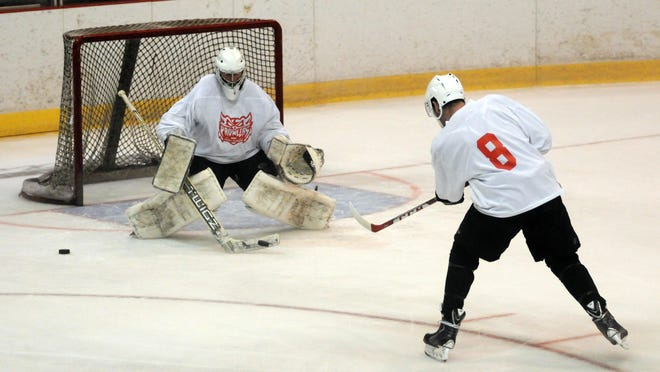 Players and goalies work on a shooting drill Sunday during the final day of prospect camp at McMorran Arena.