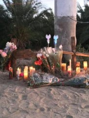 A roadside memorial set up by the victims' families