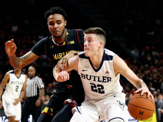 Butler guard Sean McDermott, right, drives against Maryland guard Jared Nickens during the first half of an NCAA college basketball game in College Park, Md., Wednesday, Nov. 15, 2017. (AP Photo/Patrick Semansky)