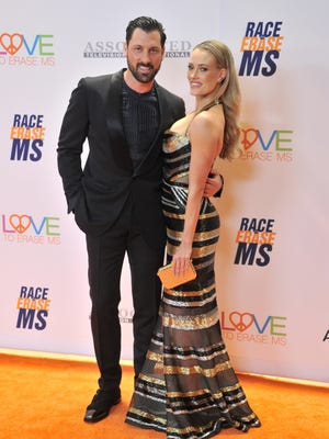 'Dancing with the Stars' pro dancers Maksim Chmerkovskiy, left, and Peta Murgatroyd were married Saturday in New York.