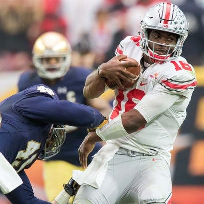 Ohio State quarterback J.T. Barrett runs for yardage