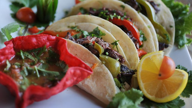 Fernando's Fajita Factory's mesquite-grilled fajitas are shown in this file photo.