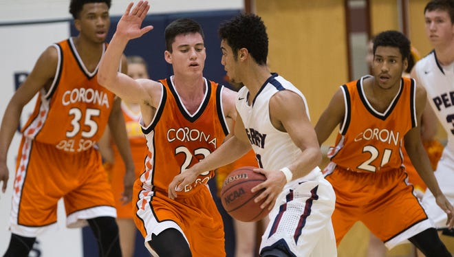 Perry High guard Markus Howard is guarded by Corona del Sol High guard Alex Barcello (23) in Gilbert on Feb. 2, 2015