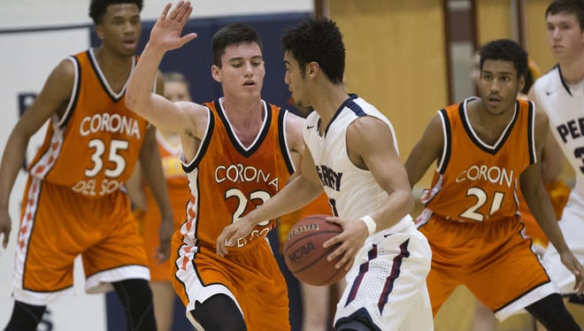 Perry High guard Markus Howard is guarded by Corona del Sol High guard Alex Barcello (23) in Gilbert on Feb. 2, 2015.