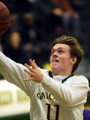 Gallatin High sophomore guard Collin Minor glides to the basket for a third-quarter layin.
