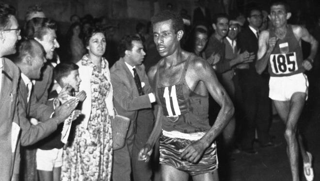 In this Sept. 10, 1960 file photo, Ethiopia's Abebe Bikila (11) leads in the final stages of the Olympic Marathon, in Rome, Italy.