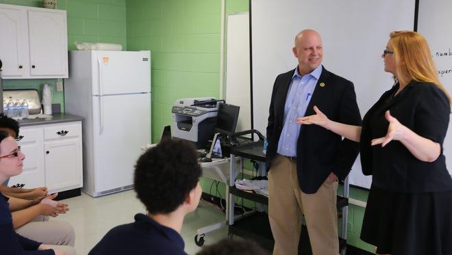 U.S. Rep. Scott DesJarlais listens to Daniel McKee Alternative School teacher Mariah Phillips on Feb. 22, 2016.