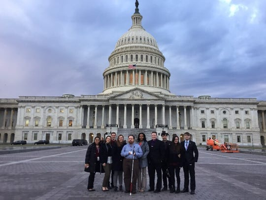 Students from Richard Stockton University stand in front of the U.S. Capitol Building.