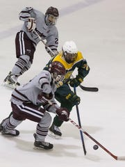 Morristown's Drew Shandlay (front) duels with Morris Knolls' Nick Rupp as Morristown's Teddy Dolan provides backup during Monday night's quarterfinal.
