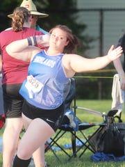 Highlands senior Mikayla Reichert throws the shot put.
