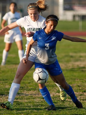 El Diamante's Carli Gordon battles with Noemi Cabello of Madera for possession during Tuesday's Central Section Division II first-round playoff game in Visalia. Madera won the match 3-0.