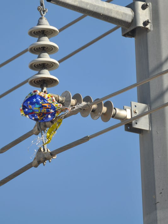 Mylar balloon stuck in power lines