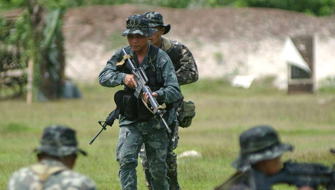 A special operations platoon of the Philippine Marine Battalion Landing Team conduct military an exercise.