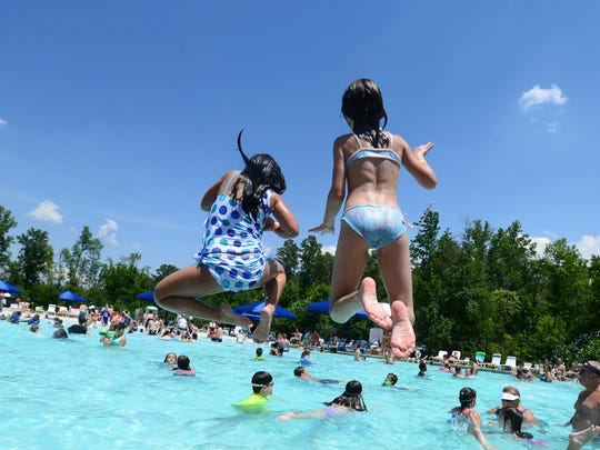 People spend time at Otter Creek, a Greenville County water park, on Thursday, June 26, 2014.