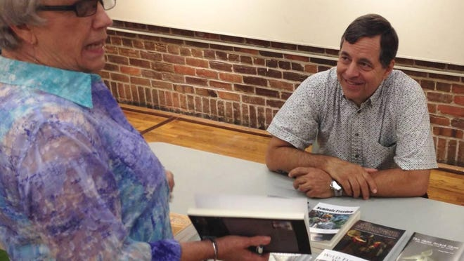 Linda Roberts chats with Doug Alderson, author, photographer, and naturalist at Senior Center Event.