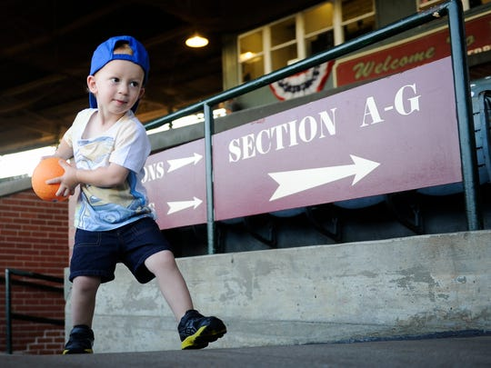 John Burch, 2, of Evansville, plays catch with his father, Nick Burch, before game five of the 2016 Frontier League Championship Series at Bosse Field in Evansville, Monday, Sept. 19, 2016.