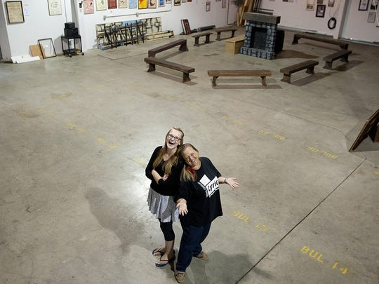 Lyric Theatre executive director Syndi Zook (right) and Kerstin Anderson, then 18, stand in the company's rehearsal and storage space.