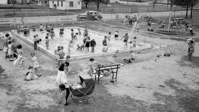 SNAPSHOT IN TIME: Algoma tots took to the Perry Field wading pool like ducks to water. The photo was taken June 20, 1950, the first day of operation for the 24-by-40-foot pool. Depths in the 9,000-gallon pool graduated from six inches to two feet. The valve system had a sump pit to catch sand, and a bottom drain provided for complete water removal. Shower heads were at one end of the pool, and water constantly changed at the rate of 10 gallons a minute. A safety cable surrounded the pool, and the area around it was blacktopped to prevent excess sand from being carried in. At least two generations of Algoma kids have memories of the popular pool, including the swimming lessons offered there.  The photo comes from the Heidmann Collection at the Algoma Public Library.