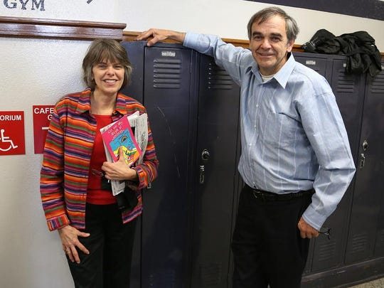 Sibling civil rights pioneers Mary Beth Tinker and John Tinker stand next to locker 319 at Harding Middle School in 2014. The locker was dedicated for the Tinkers.