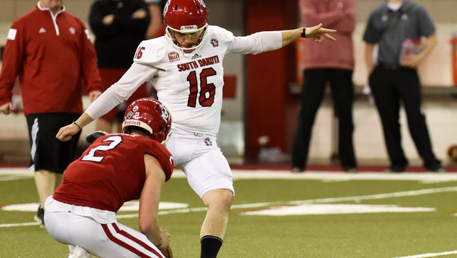 USD kicker and punter Miles Bergner, here kicking in the spring game, set a record this year for field goals at USD. He's also leading the nation in punting.