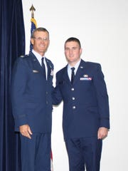 Colonel Phil Murdock (Retired), former Commander of the Vermont Air National Guard's 158th Fighter Wing, saw his oldest son Tyler, right, follow in his footsteps as an airman.