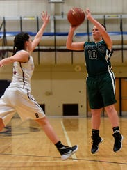 Groves guard Emilie Felix launches a long-range shot
