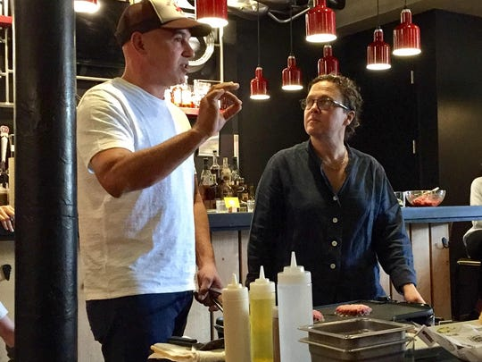 Chef Michael Symon talks about the Impossible Burger with chef Traci Des Jardins Friday morning in Royal Oak about the new meatless, cholesterol-free patty that made its debut Friday at the Royal Oak B Spot.