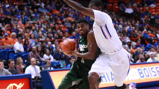 CSU guard Antwan Scott, one of three first-year starters for the Rams, tries to drive against Boise State's Mikey Thompson on Saturday during an 84-80 loss to the Broncos at Taco Bell Arena in Boise, Idaho.