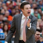 Louisville basketball head coach Rick Pitino instructs his team against Michigan State during the Elite 8 tournament game in Syracuse, NY.   March 29, 2015