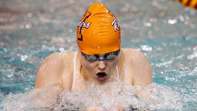 Harrison's Silvia Lawson-Vilches competes in the 100 breaststroke against McCutcheon Tuesday, December 15, 2015, at McCutcheon High School.