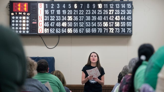 Kayli Rentzel, a senior at Northeastern High School, helps with Bingo at the Eagle Fire Co No. 1 in Mount Wolf.