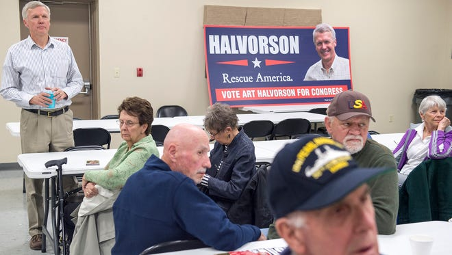 Art Halvorson listens to an audience member ask him a question inside the Mont Alto Fire Department Hall on Thursday, March 31, 2016. Halvorson is running against U.S. House of Representatives Bill Shuster this November 2016 election.