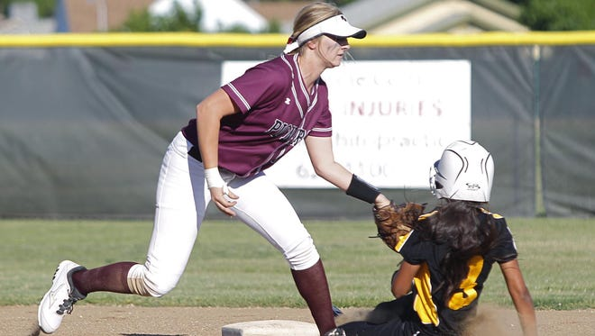 Mt. Whitney's Kaitlyn Coffman applies the tag on Golden West's Bre Wilson in a West Yosemite League softball game Thursday in Visalia.