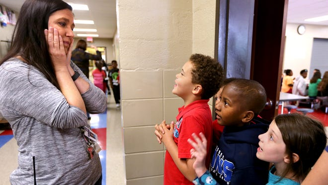 Hobgood principal Tammy Garrett, left, interacts with first-graders, from left, Calvin Davis, King Knight and Kizzie Denoyer as the students leave the cafeteria after lunch.