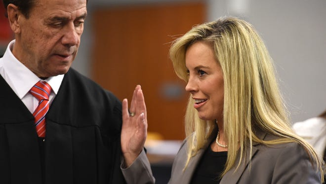 Hillary Schieve in sworn in as Reno Major by Judge Peter Sferrazza during Wednesday's Reno Council Meeting on Nov. 12, 2014.