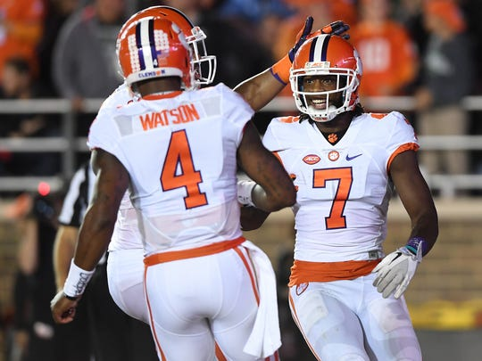 Clemson quarterback Deshaun Watson (4) and wide receiver Mike Williams (7) celebrate after a touchdown pass on Oct. 7, 2016.