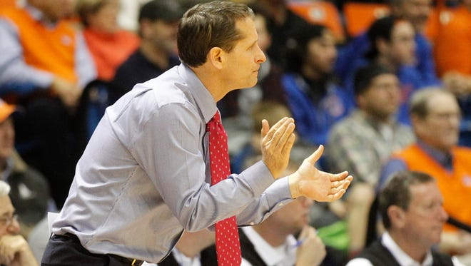Wolf Pack coach Eric Musselman directs his team during a game against Boise State.