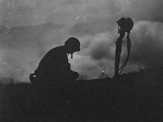 A Marine mourns the loss of a friend during the Battle of Okinawa.