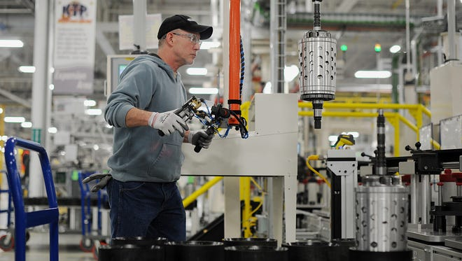 Employee Dietz Werland removes transmission parts from the assembly line at the Chrysler Group LLC transmission plant in Kokomo, Indiana, U.S. Chrysler Group LLC, the automaker majority owned by Fiat SpA, will invest about $374 million and add 1,250 jobs at Indiana factories to boost output of eight-and nine-speed transmissions.