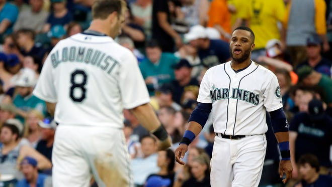 Seattle Mariners' Robinson Cano, right, walks on the field after he grounded into a double play with the bases loaded to end the fourth inning of a baseball game against the Tampa Bay Rays. Mariners' Willie Bloomquist (8) was left on base on the play. Cano isn't supposed to hear boos at home. It wasn't part of the deal when he signed for $240 million and 10 years in Seattle. But with the underperforming Mariners having the second-worst record in the American League, Cano's struggles have become the focus for the floundering franchise.
